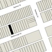 Irregular Lot 24.94' on Marlborough, 25.07' on Alley 420, 112' North-South (2,800 sf)