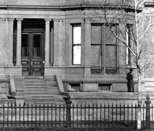 17 Commonwealth (ca. 1870), showing extension to left of stairs, with man standing on it; detail from photograph by Frederick M. Smith, II; courtesy of the Print Department, Boston Public Library